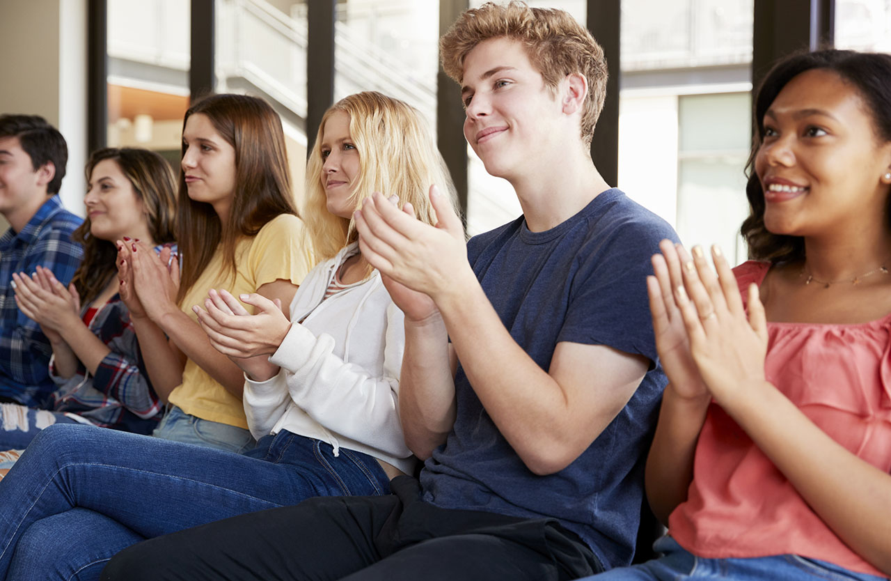 Group Of High School Students Applauding Presentation